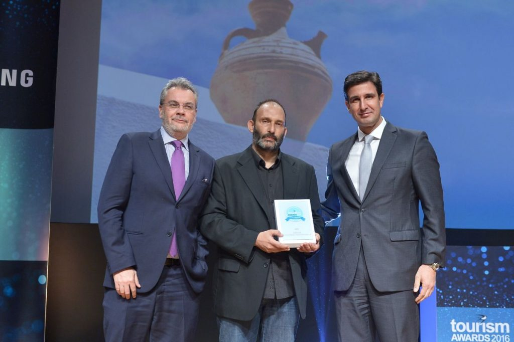 The president and founder of HotelBrain, Panos Paleologos (center), with the company's CEO, Kostas Zikos (left) and the Secretary General of the Greek National Tourism Organization, Dimitris Tryfonopoulos.
