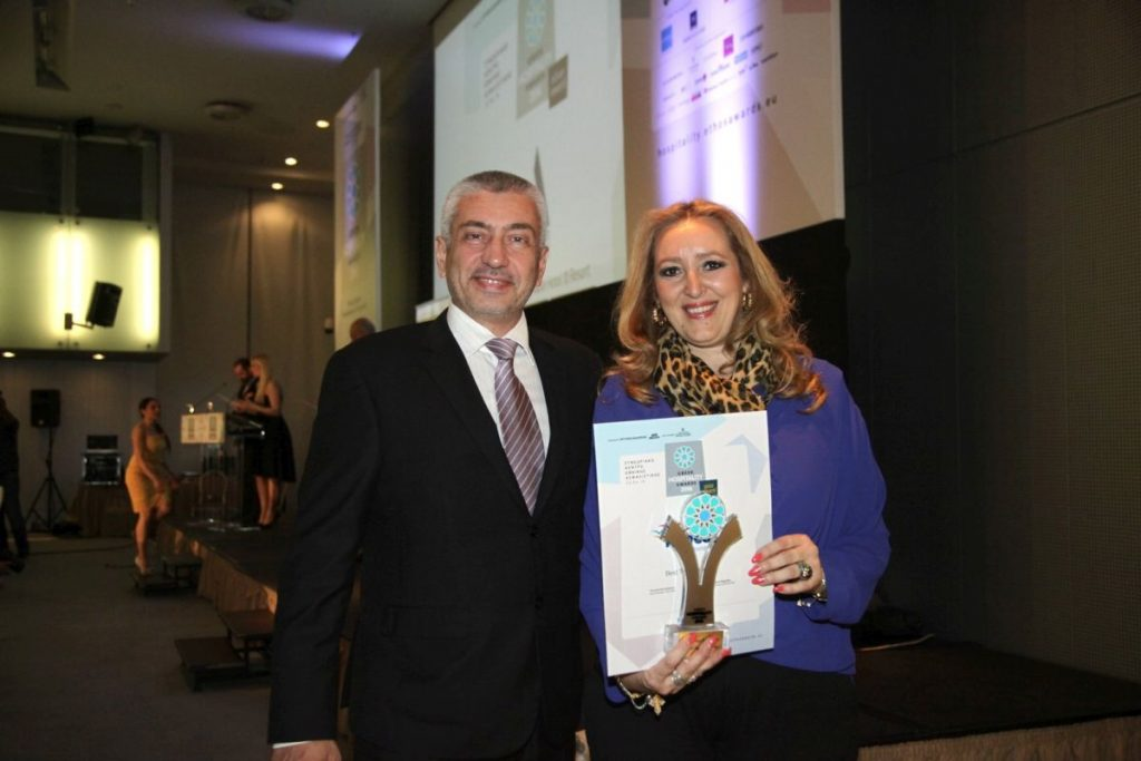 """Mideast's managing director, Katerina Mousbeh, holding the Greek Hospitality 2016 """"Gold Award"""" for Greece's Best Tour Operator."""