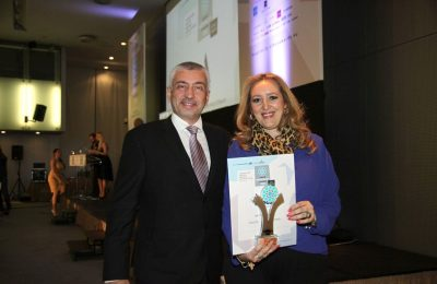 Mideast's managing director, Katerina Mousbeh, holding the Greek Hospitality 2016