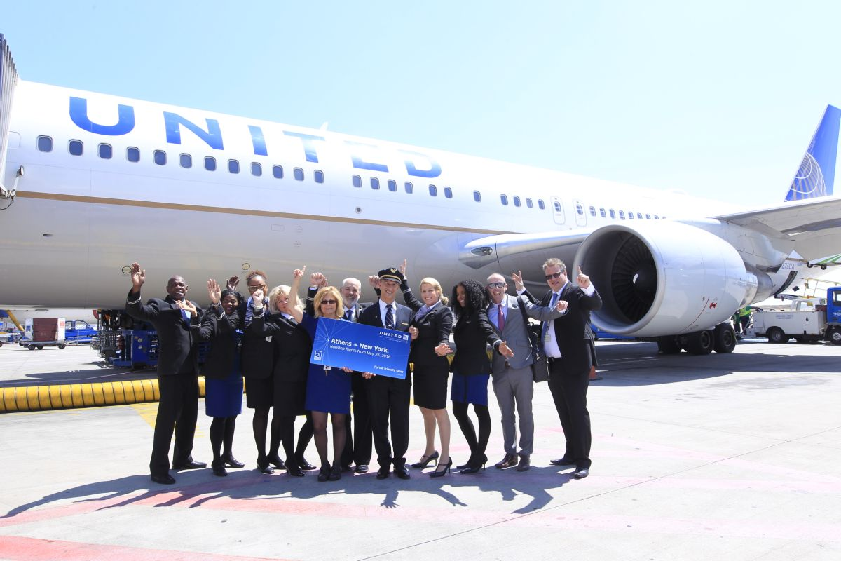 The crew of United Airlines flight UA125 celebrate the launch of Athens-New York/Newark nonstop service today, May 26.