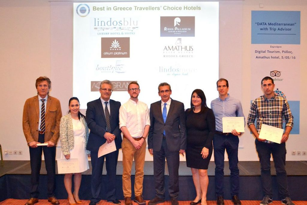 """The South Aegean's prefect, George Hadjimarkos (center) and vice governor of tourism, Marietta Papavasileiou (third from right) with E-Tourism Frontiers' Damian Cook and TripAdvisor's Chad Shiver and Greek hoteliers that won """"Best in Greece Travelers Choice Awards""""."""