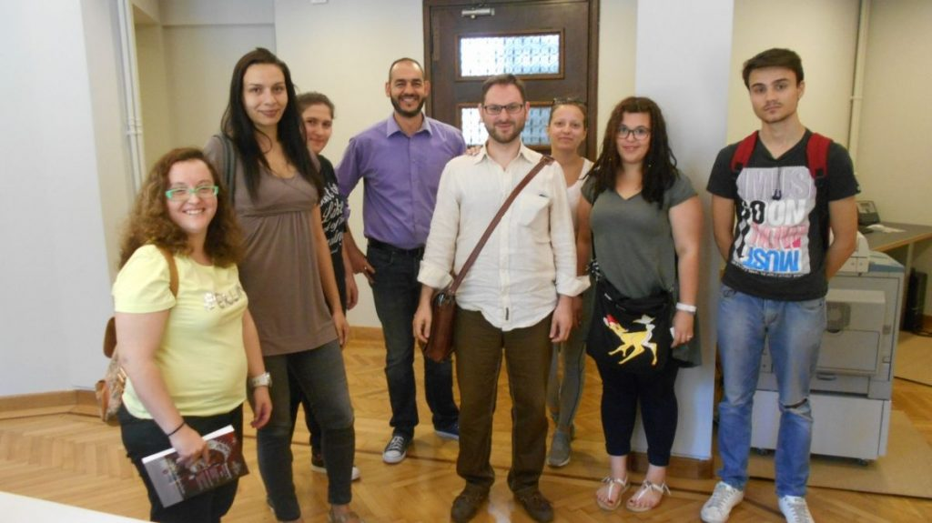 Greek Travel Pages' sales and advertising manager, Charis Brousalian, with the students from IEK New York, during their tour of GTP's offices.