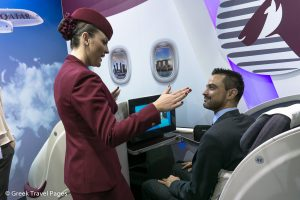 A member of Qatar Airway's cabin crew infomrs GTP's managing editor, Nikos Krinis, on the airline's B787 Dreamliner Business Class Seat.