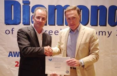 The representative of Porto Carras Grand Resort, Nikos Stathakis, receiving the prize.