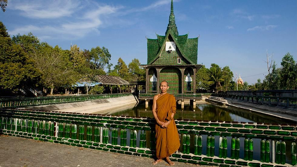 Ecoweek Chairman Elias Messinas showed a picture of eco-architecture in practice - a Thailand temple made of beer bottles - during Ecoweek 2016 Crete, on Monday.