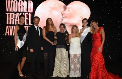 HotelBrain's Eleni Janou, chief operating officer; Roula Korbou, director of sales & revenue; and Flora Paraskevopoulou, PR & communication director, receiving thw two World Travel Awards accolades.