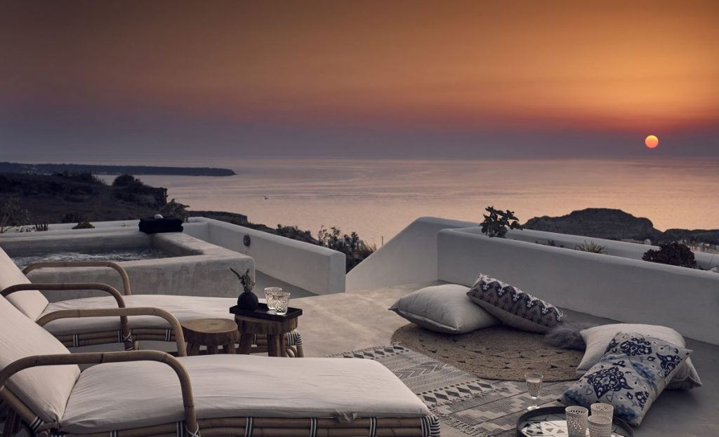 A Santo Maria Oia suite at sunset.