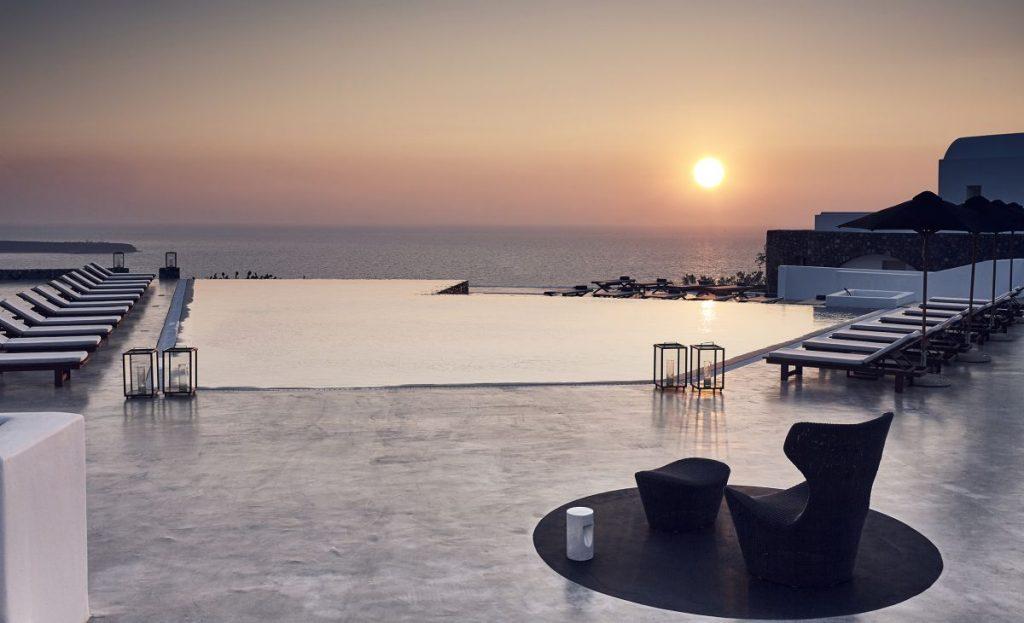 Santo Maris Oia's pool at sunset.