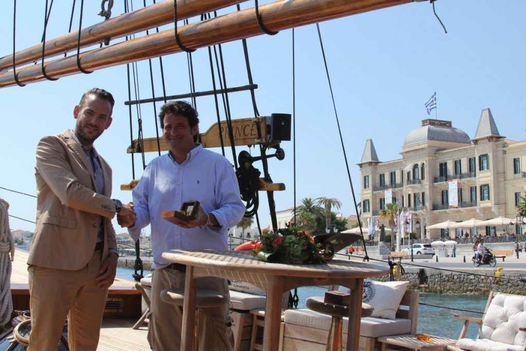 Kivotos manager Jason Michopoulos and Poseidonion Grand Hotel CEO Antonis Vordonis on the 25-meter schooner, the Prince de Neufchatel, moored in front of the Poseidonion Grand Hotel.
