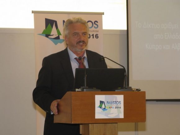 """Session: Local Authority Initiatives for rural tourism development, laying emphasis on the water element - Dorida Mayor and 'Cities with Lakes' Network President Georgios Kapentzonis giving a presentation on """"Lakes and waterside areas of network members, as a multidimensional tourism destination""""."""