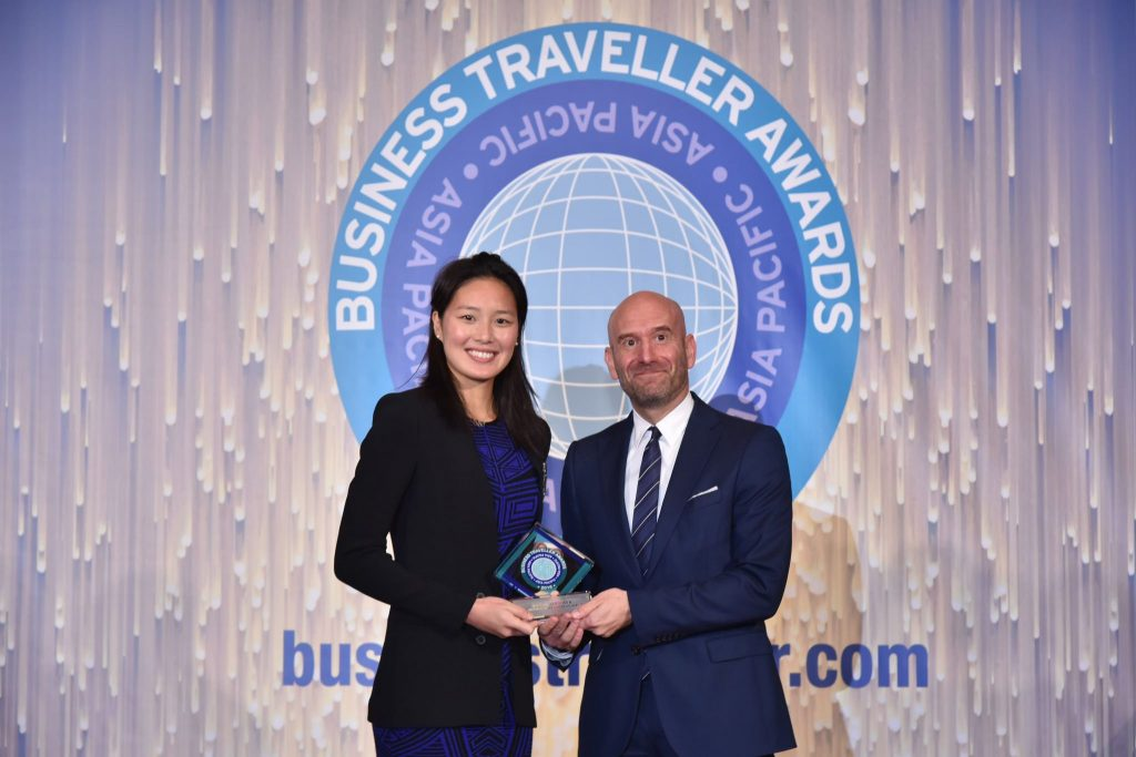 Qatar Airways Vice President North Asia, Paul Johannes receiving the Business Traveller Award from Hong Kong's 2016 Olympian, Yvette Kong.
