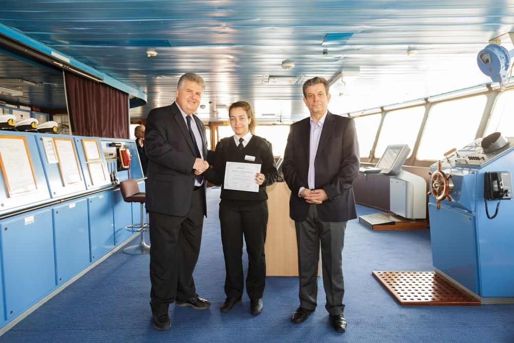 Vice President of Operations, Captain George Koumpenas awards annual scholarship to high-school student of AEN Syros Sophia Exilze presence of Port Captain Nick Koufogiannis