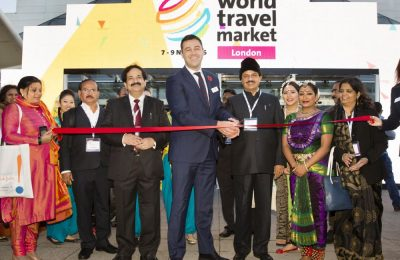 World Travel Market 2016, ExCeL, London - WTM 2016 Exhibition Opening Ribbon Cutting by Simon Press, World Travel Market Senior Exhibition Director & Dr Mahesh Shama, Minister of Tourism & Culture, Government of India. With (Left) Mr Shri Vinod Zutshi, Secretary, Ministry of Tourism, India.