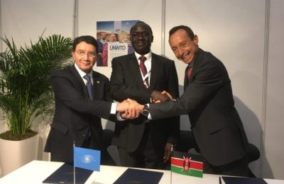 Juan Torres, East Africa Regional GM, Amadeus IT Group; Taleb Rifai, United Nations World Tourism Organization (UNWTO) Secretary-General; and Lazarus Amayo, the High Commissioner in the UK from the Kenyan Ministry of Tourism, signed the global CSR plan.