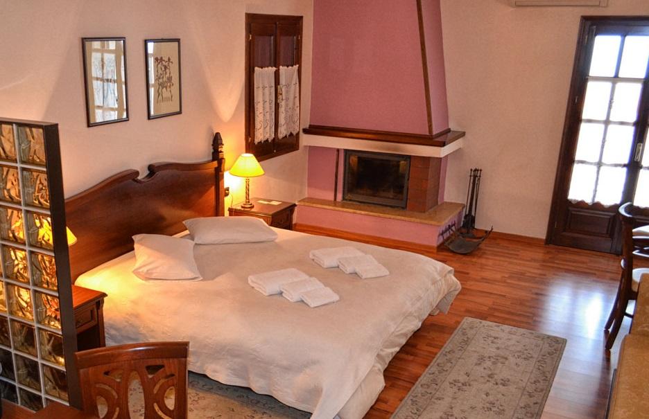Room with fireplace. Aglaida Hotel & Apartments, Pelion.