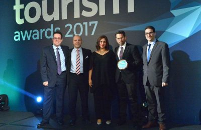 Aqua Vista Hotels' assistant director of sales, Alexander Dardoufas; director of sales, Yiorgos Tsolakakis; business development manager, Sophia Matzouranis; and the architect and owner of the Kassandra Bay, Leonidas Bays, receiving the Gold Award in the