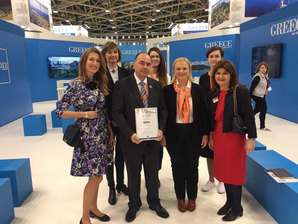 GNTO Director for Dept Russia and CIS Polykarpos Efstathiou holding the Best Presance at MITT 2017 award that was given to the Greek stand. On his left is Aggeliki Fotopoulou from the GNTO's market research & advertising department.