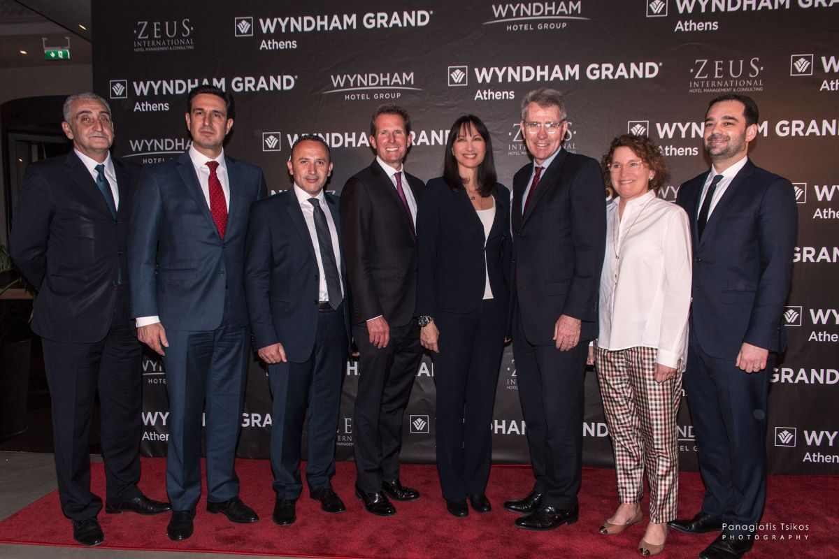 Wyndham Grand Athens General Manager Giorgos Margaritis, GNTO Secretary General Dimitris Tryfonopoulos, Zeus International Founder Haris Siganos, Wyndham Hotel Group President & CEO Geoff Ballotti, Tourism Minister Elena Kountoura, United States Ambassador Geoffrey Pyatt and Wyndham Hotel Group EMEA Chairman and Managing Director Daniel Ruff.