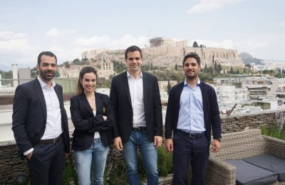 The blueground team on the balcony of one the residential properties it manages.