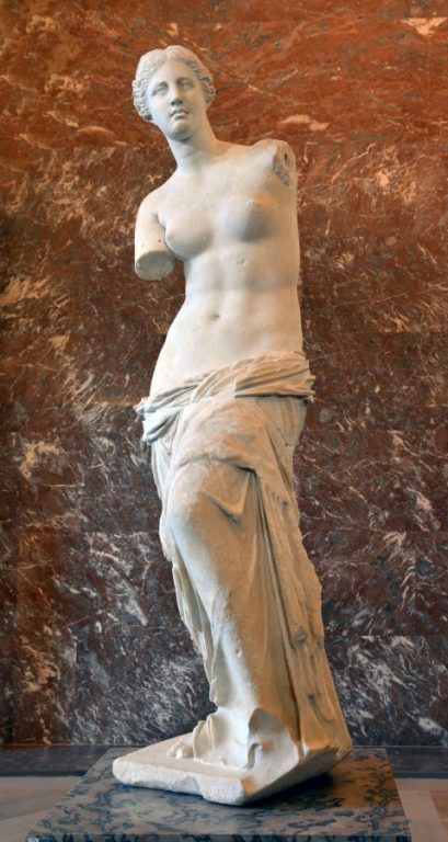 The Venus de Milo statue displayed at the Louvre Museum in Paris, France.