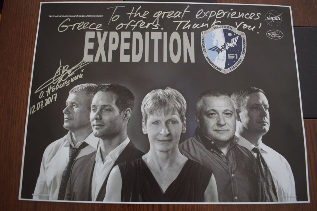 "Novitskiy gave Minister Kountoura an autographed poster of his recent expedition on which he mentions ""the great experiences Greece offers""."