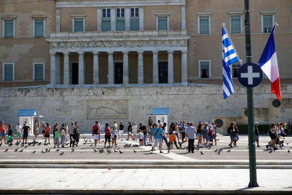 The Greek and French flags outside of the Hellenic Parliament on Thursday.