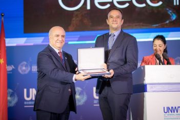 """The diplomatic advisor to the Greek Tourism Minister, Michail Angelopoulos (left) receiving the award for """"Best video in Europe""""."""