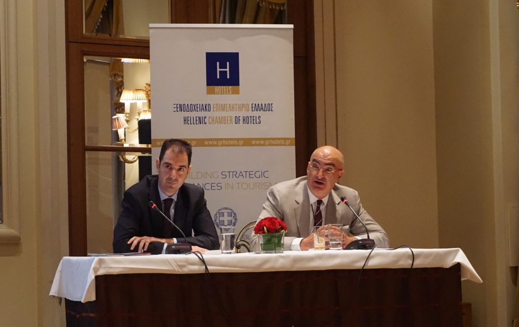 Hellenic Chamber of Hotels President Yiorgos Tsakiris (right) with representative from Grant Thornton.