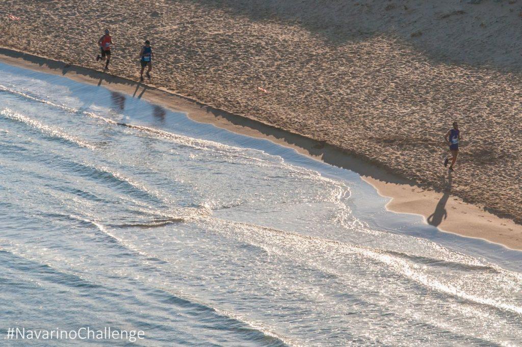 Navarino Challenge runners crossing Voidokilia beach (photo by Elias Lefas).