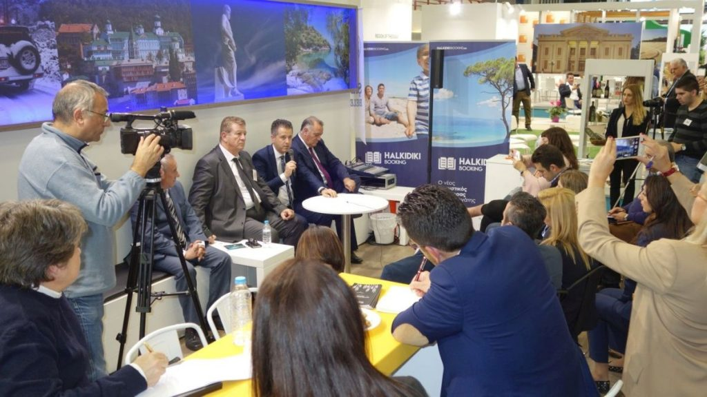 Halkidiki Hotel Association President Grigoris Tasios speaking to the press during the Philoxenia exhibition.