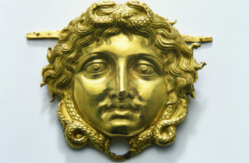 Golden gorgoneion from the armour of Phillip II. Photo Source: Polycentric Museum of Aigai