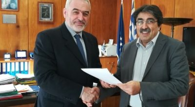 Alexandros Aravanis, Athens International Airport Chief Operations Officer / Delegate Accountable Manager receiving the safety certificate from Hellenic Civil Aviation Authority Governor Konstantinos Linzerakos.