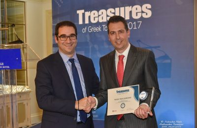 Mideast Travel commercial director Stelios Dimitriou (right) receives the
