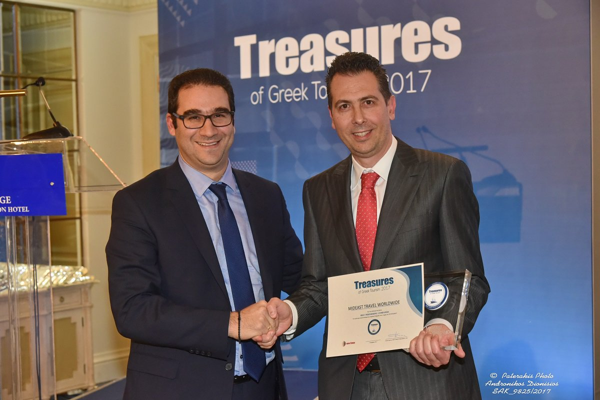 "Mideast Travel commercial director Stelios Dimitriou (right) receives the ""Treasures of Greek Tourism 2017"" award."