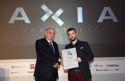 Axia Hospitality founder and CEO received the award from deputy foreign minister Ioannis Amanatidis.