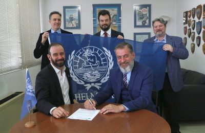 Capt. Nicholas Pagonis hands over to Michael Dalacouras the signed membership registration forms under the banner of HELMEPA, in the presence of assistant executive coordinator Costas Triantafillou, Dimitris Giakos, membership services of HELMEPA and Capt. Gerassimos Limperatos.