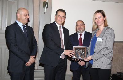 Marketing Greece CEO Ioanna Dretta receives the honorary plaque by the Minister of Energy, Commerce, Industry and Tourism of Cyprus Georgios Lakkotrypis. Also present at the conference were the president of the Cyprus Hotel Managers Association Charis Loizidis and the Chairman of the Parliamentary Committee for Commerce, Industry and Tourism Angelos Votsis.