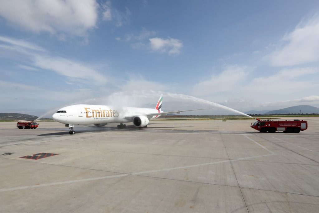Emirates' Boeing 777-300ER aircraft receiving a water salute by Athens Airport.