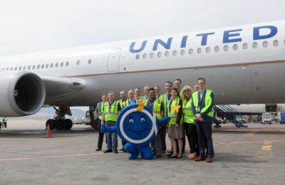 "United team and Athens airport mascot, ""Philos the Athenian"", in front of the Boeing 767-400ER at Athens International Airport."