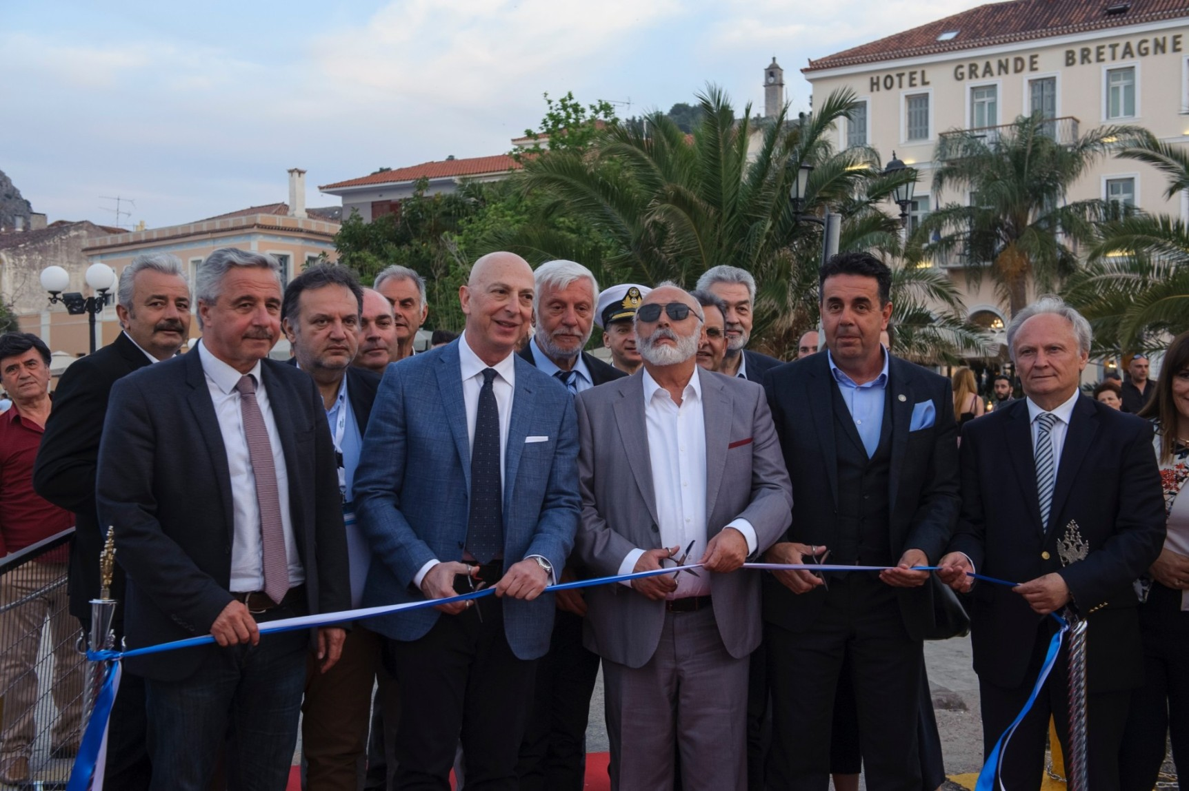 (from left to right) Mr Giannis Maniatis, Member of Parliament for Argolida, Mr Michael Skoulikidis, President of the Greek Yachting Association (GYA), Mr Petros Tatoulis, Regional Governor of the Peloponnese, Mr Panagiotis Kouroumplis, Minister for Maritime Affairs and Insular Policy, Mr Dimitris Kostouros, Mayor of Nafplion, Mr Ioannis Andrianos, Member of Parliament for Argolida, cutting the ribbon during the opening ceremony.