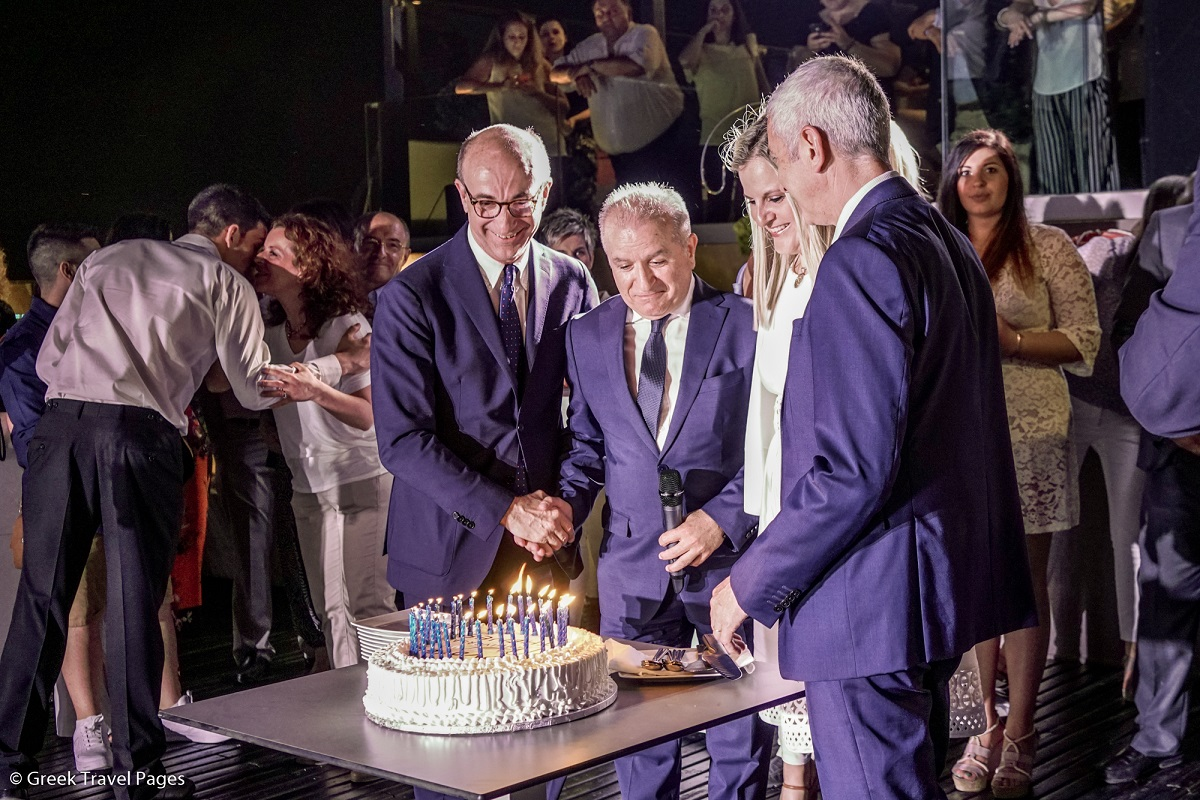 Chief Operating Officer of AccorHotels or Italy, Greece, Israel and Malta Renzo Iorio; Novotel Athènes General Manager Evripides Tzikas and Secretary General of Tourism Evridiki Kourneta cut the cake for the 30th anniversary of Novotel Athènes in the Greek capital. Photo: GTP