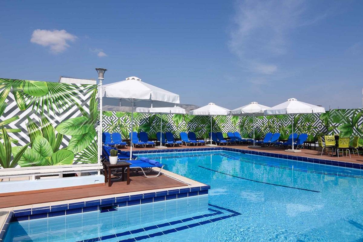 The pool area of the Poseidon Athens Hotel.
