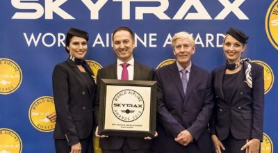 AEGEAN Chief Financial Officer Mihalis Kouveliotis, with cabin crew members, after receiving the award from Skytrax CEO Edward Plaisted. Photo source: AEGEAN
