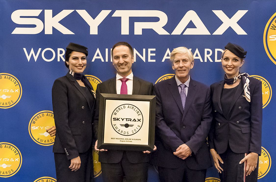 AEGEAN Chief Financial Officer Michael Kouveliotis, with cabin crew members, after receiving the award from Skytrax CEO Edward Plaisted. Photo source: AEGEAN