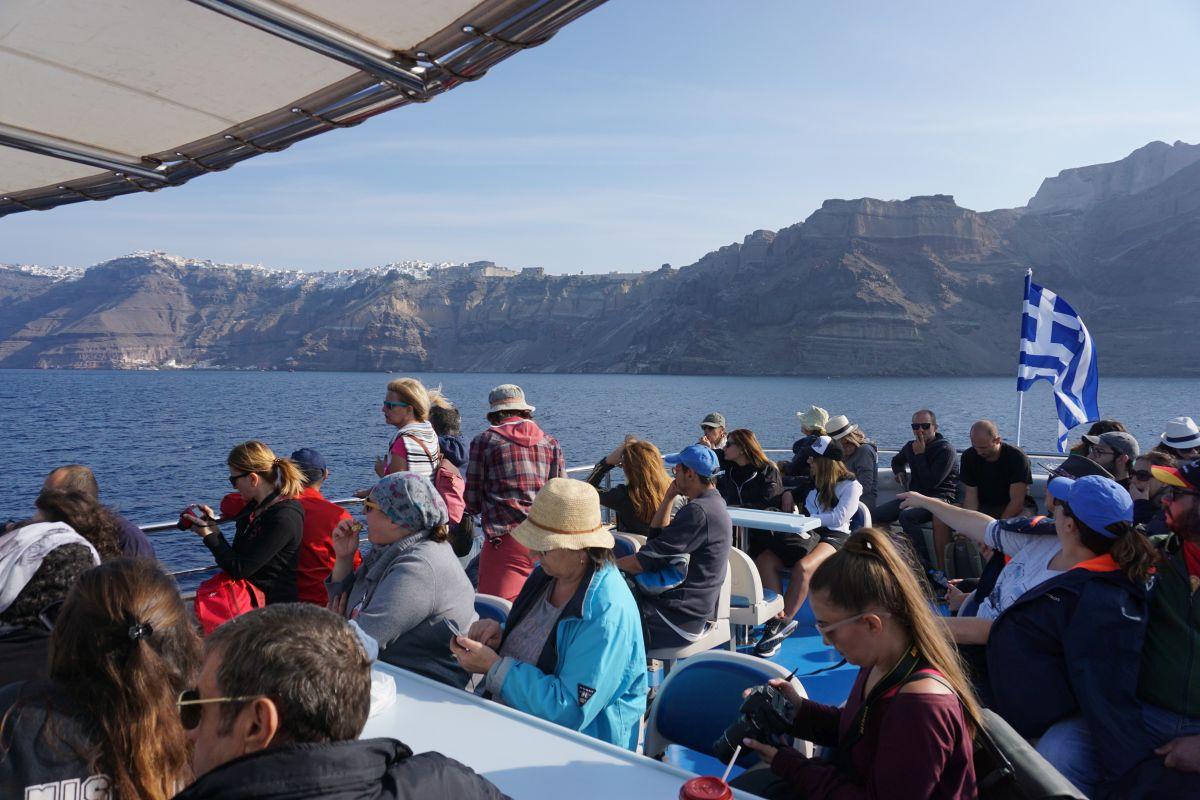 Tourists on their way for a tour of Santorini's Nea Kameni volcano. Photo © GTP