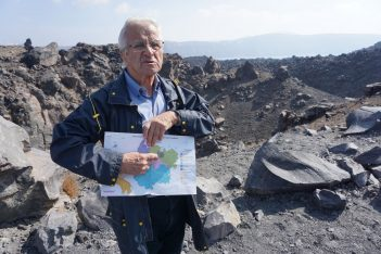 Michalis Fytikas, a professor of geology and expert on volcanological investigation and volcanoes monitoring, standing in front of one of the craters on Nea Kameni. Photo © GTP