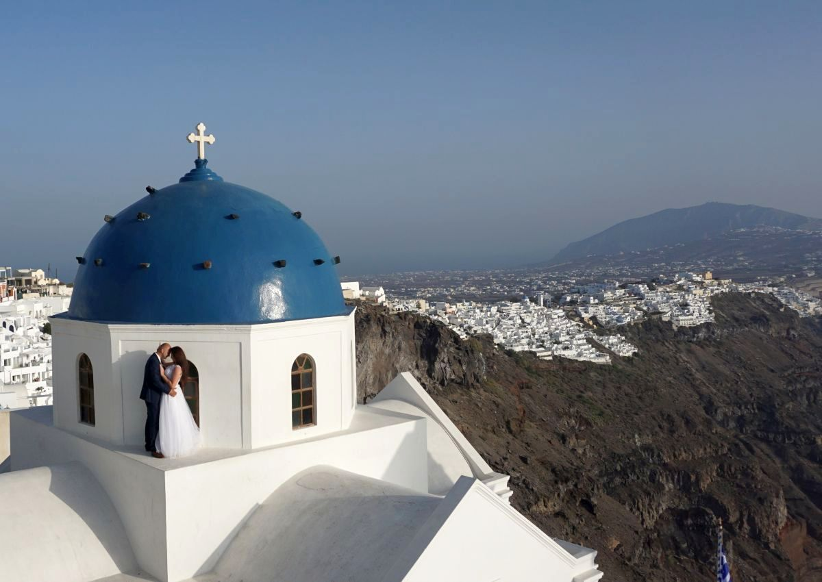 For years Santorini has been established as the ideal destination for wedding tourism with its volcanic caldera in high demand to serve as a backdrop for weddings, marriage proposals and vow renewals. Photo © GTP