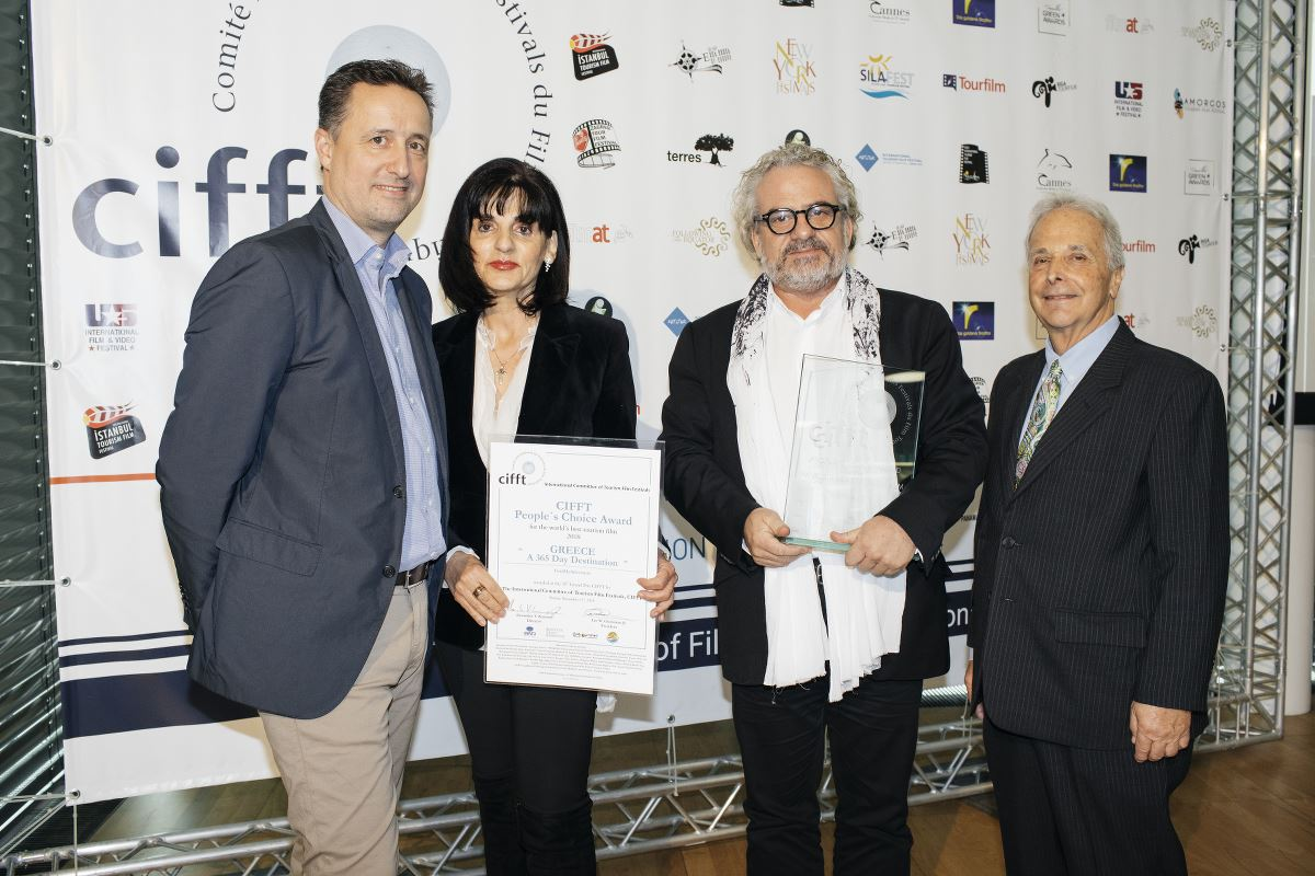 "The CIFFT ""People´s Choice"" Award World's Best Tourism Film 2018 was received by the director of the ""Greece – A 365-day Destination"", Andonis-Theocharis Kioukas and GNTO director in Austria, Eleni Melita. Photo source: CIFFT"