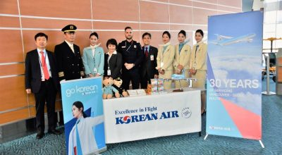 Korean Air's regional manager in Vancouver, Lim Young Don (fourth from the right), and Vancouver Airport Station Manager, Kim Chang Woo (first from the left) pose together with flight attendants and airport employees at Vancouver International Airport.