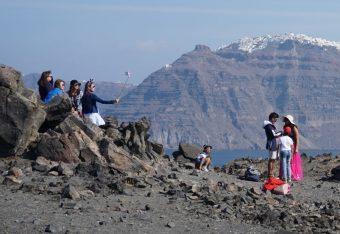 Tourists on Santorini's volcano. Photo © GTP